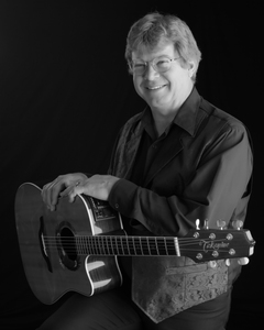 Jim curry bw with guitar